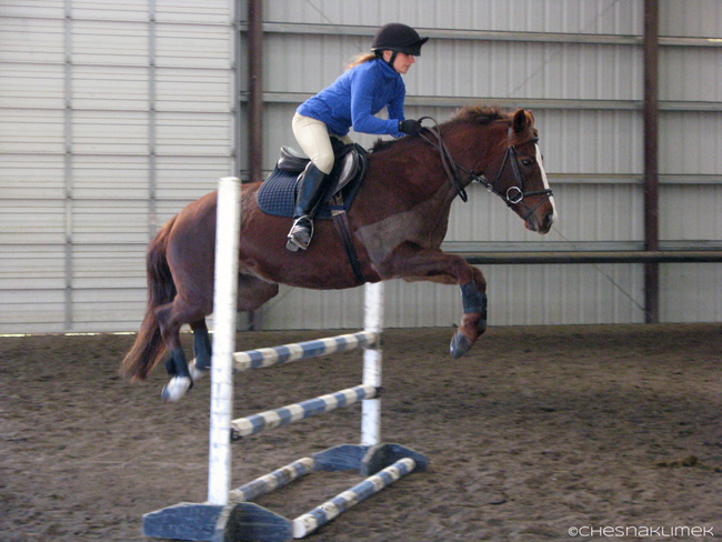 Novice rider jumping stadium