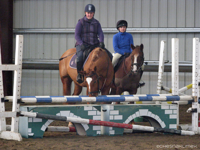Two riders waiting during a jump clinic