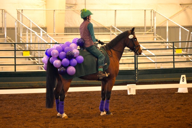 Horse dressed as a grape