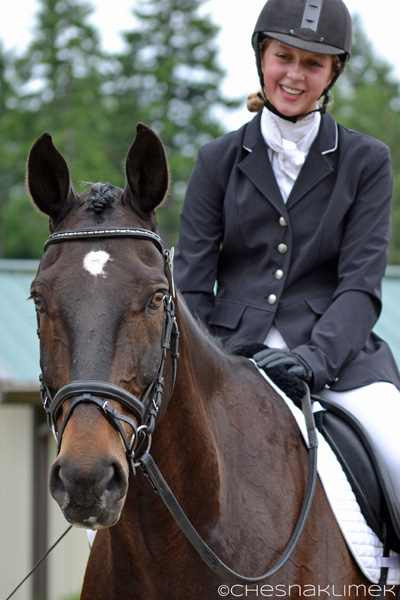 Smiling dressage rider and her horse