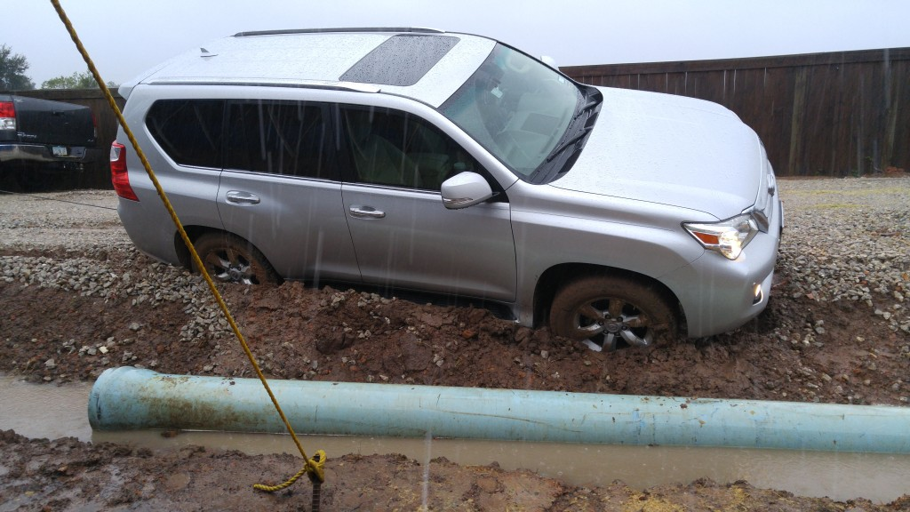 Car stuck in a muddy ditch