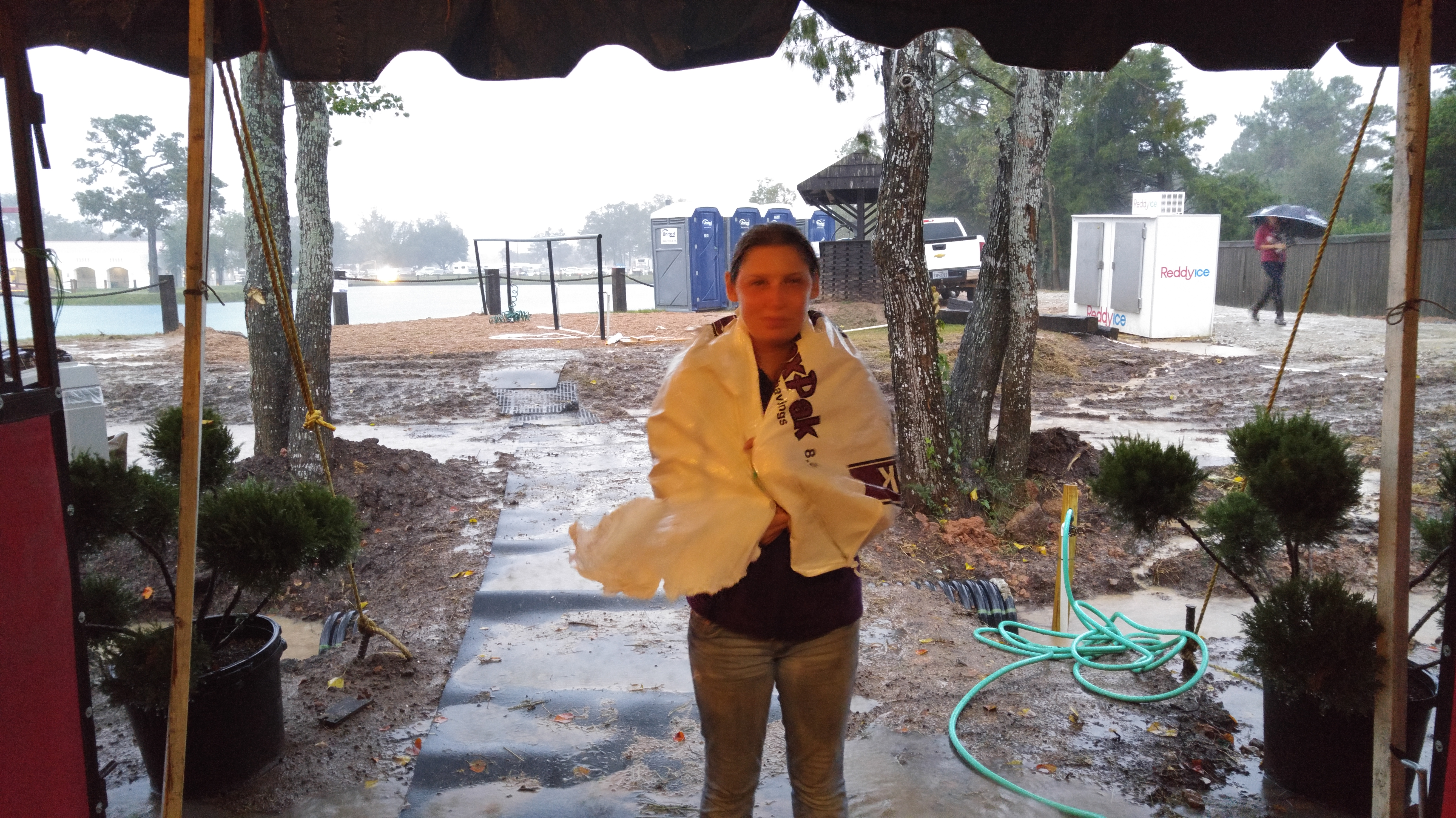 Girl using a feed bag as an umbrella